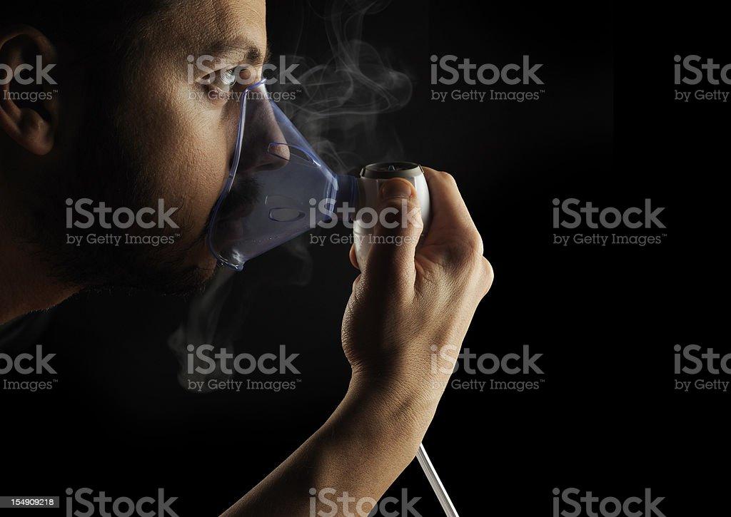 Inhalation therapy profile on black background stock photo