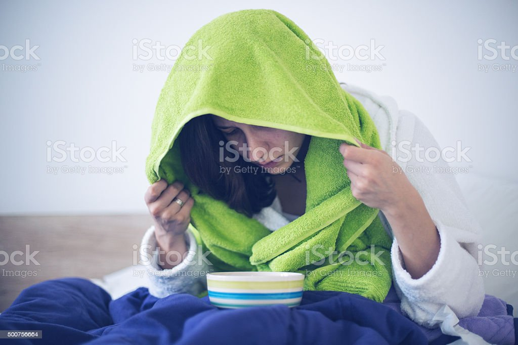 Inhaling with herbs stock photo