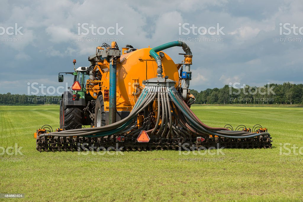 Injecting liquide manure with tractor stock photo