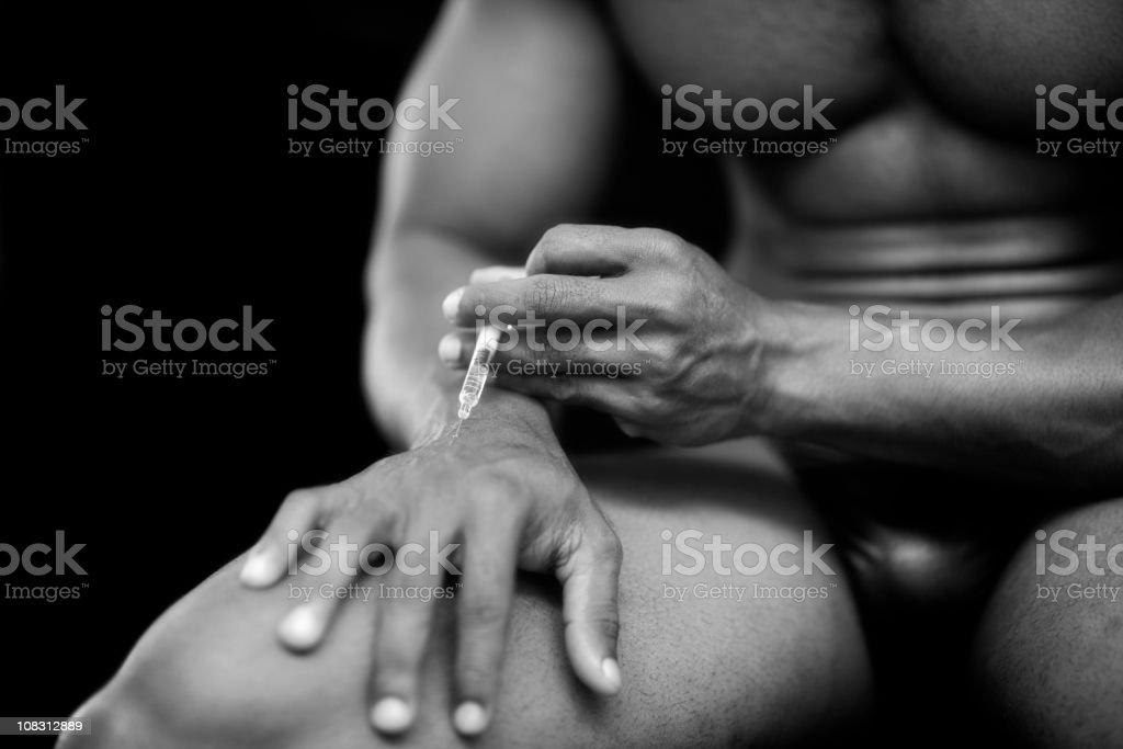 injecting steroids or drugs stock photo