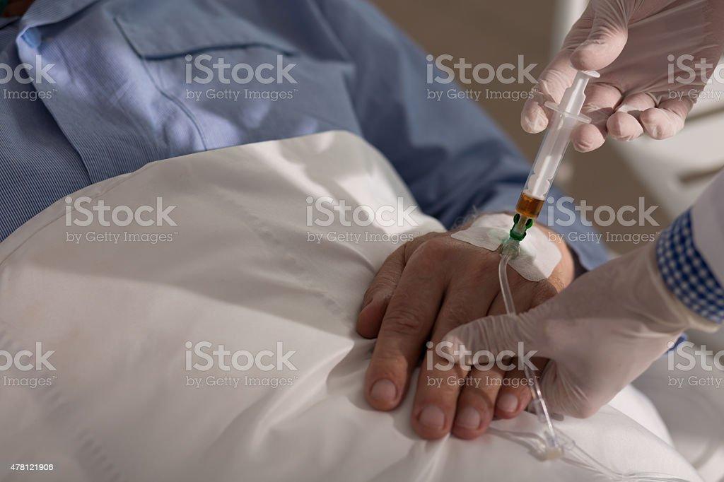 Injecting the medicine stock photo