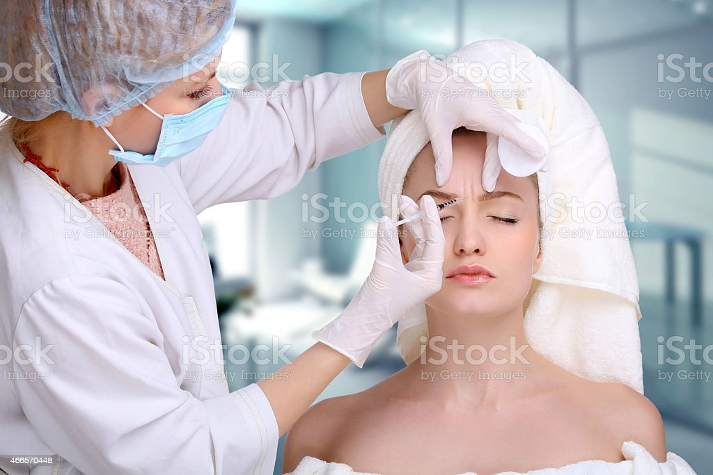 Injection in her face royalty-free stock photo