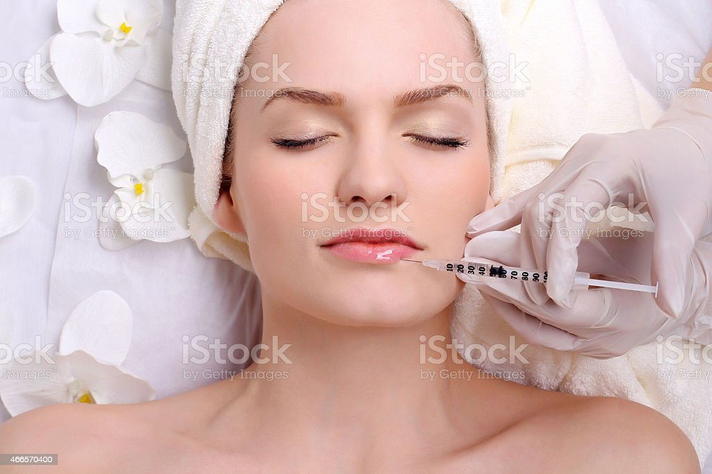Injection in her lips royalty-free stock photo