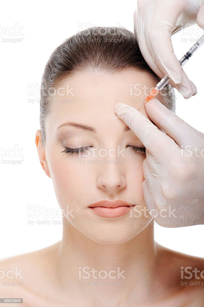 injection in the eyebrow royalty-free stock photo
