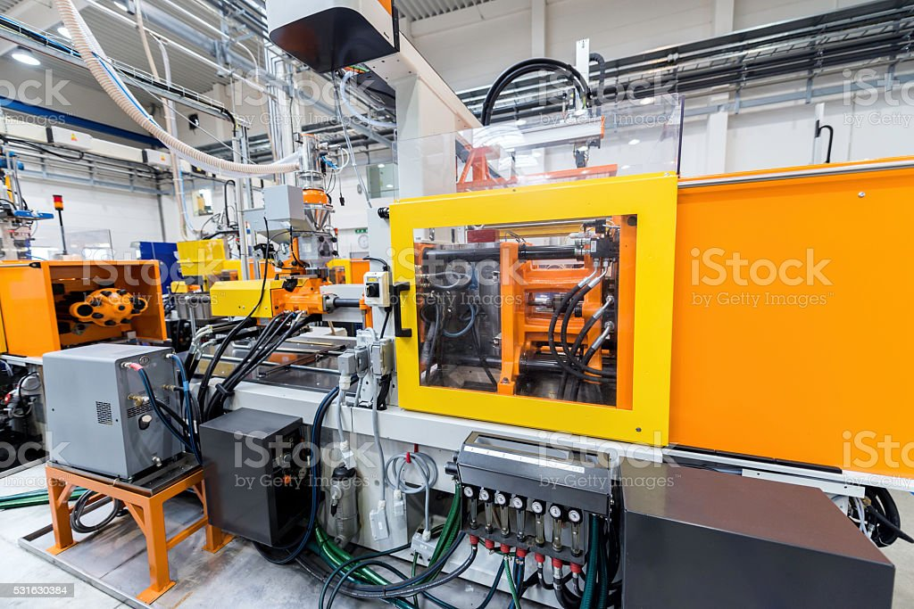 Injection molding machine in factory stock photo