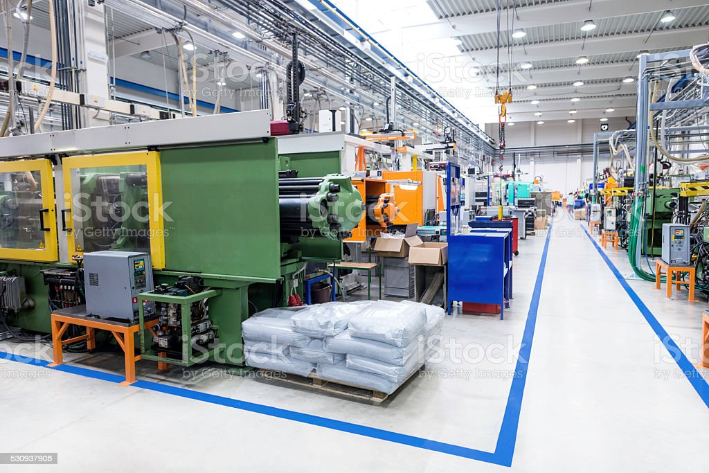 Injection moulding machines in industrial building stock photo