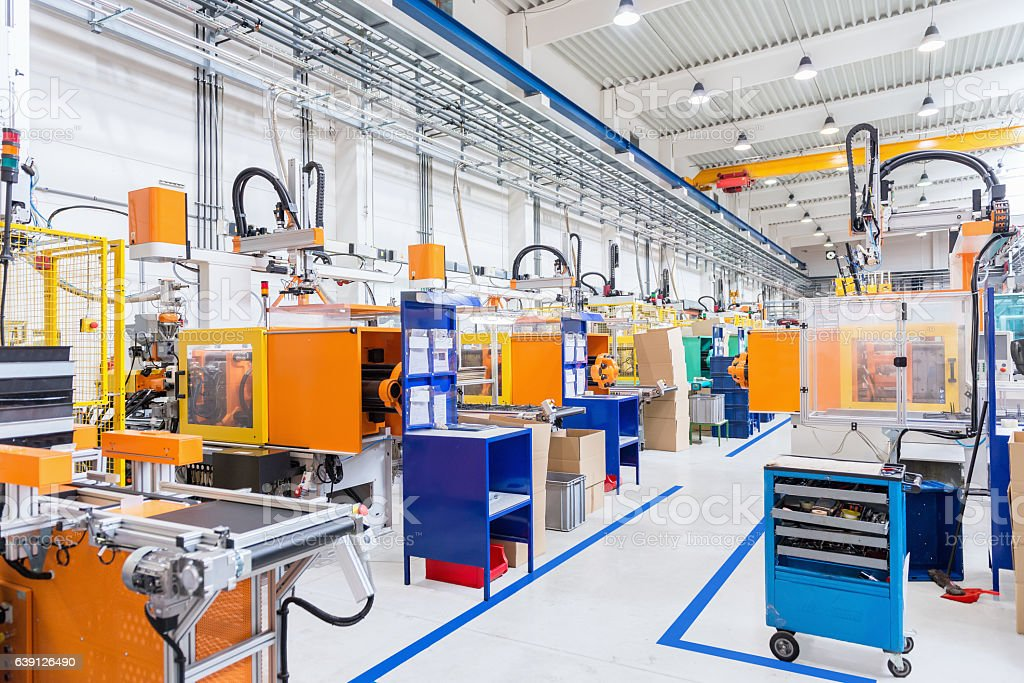 Injection moulding modern machines in factory stock photo