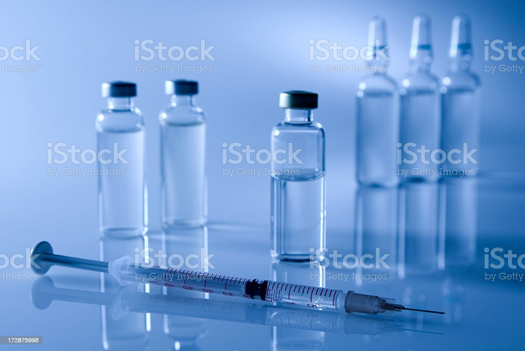 Injection needle and glass pots royalty-free stock photo