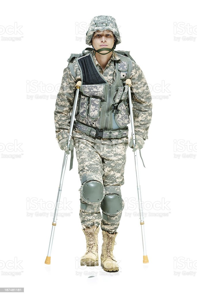 Injured army man walking with crutches royalty-free stock photo