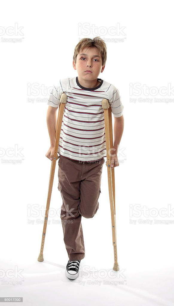 injured boy on crutches royalty-free stock photo