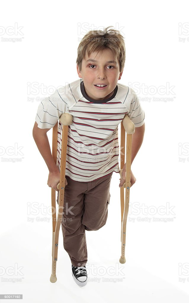 Injured child using crutches royalty-free stock photo
