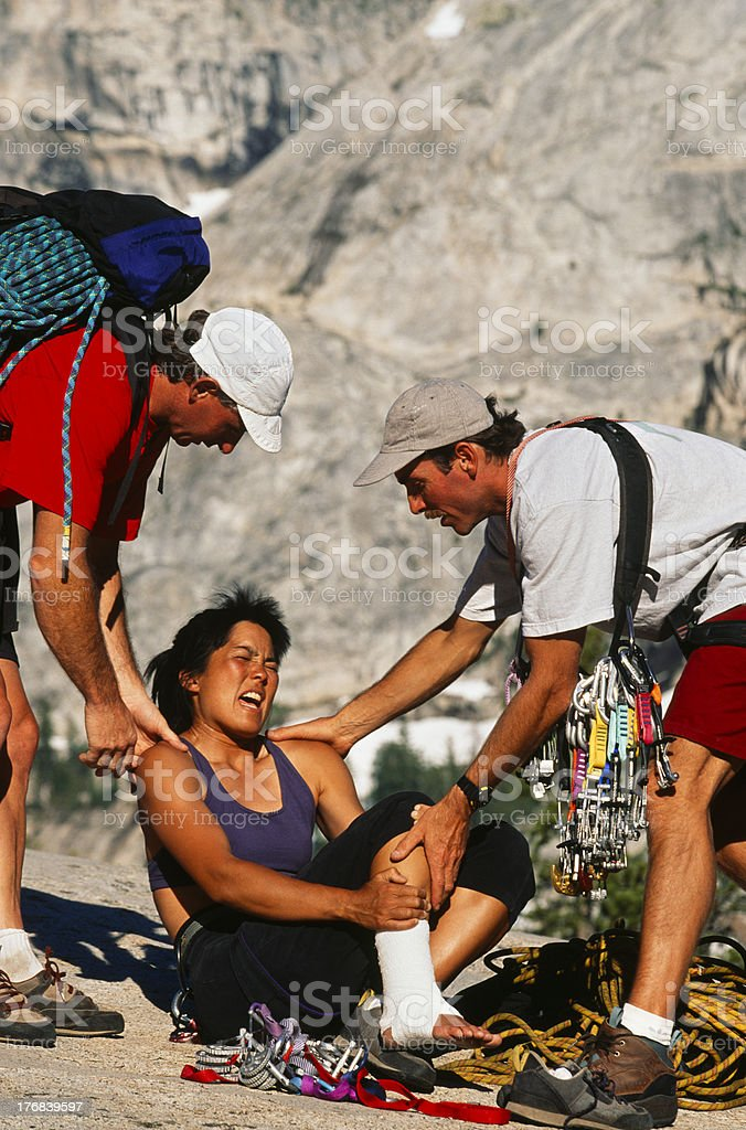 Injured climber being rescued. stock photo