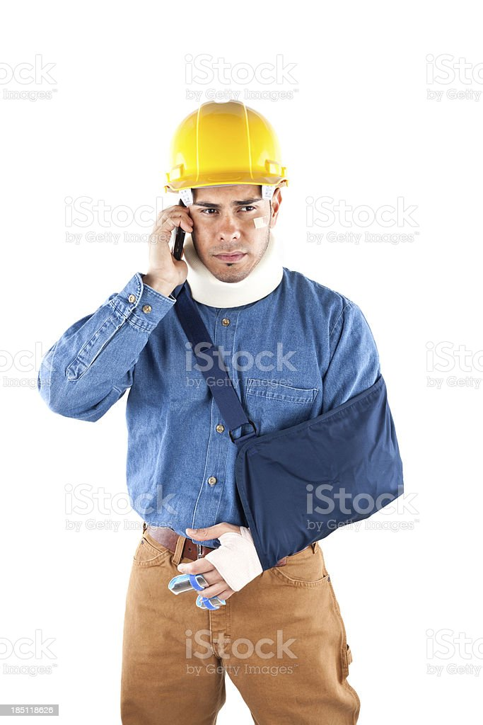 injured construction worker on phone royalty-free stock photo