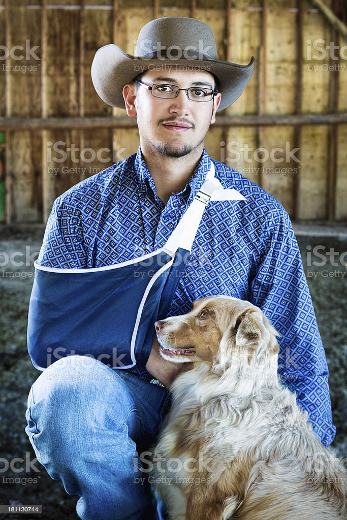Injured Cowboy with his dog royalty-free stock photo