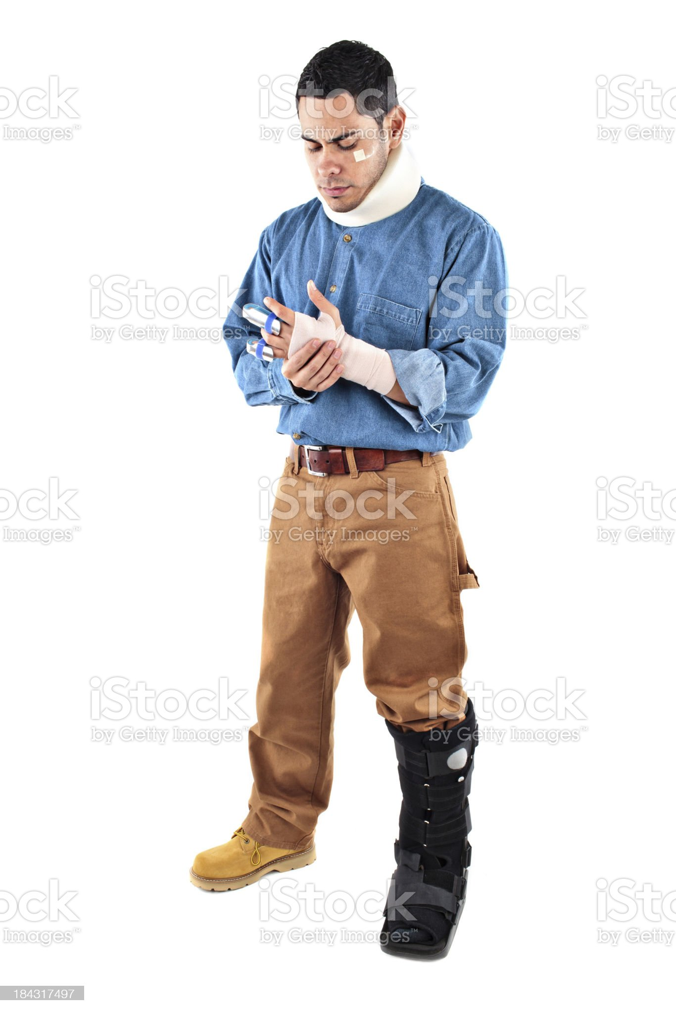 Injured male worker holding his hand royalty-free stock photo
