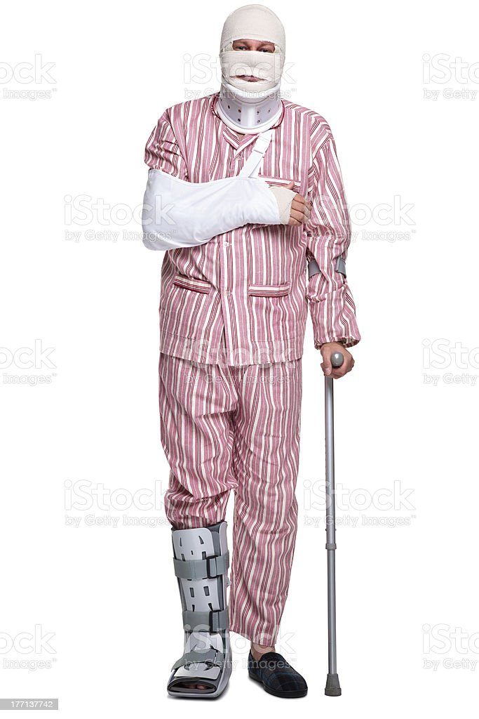 Injured man walking on crutches stock photo