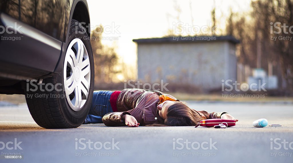 Injured pedestrian in a car accident stock photo