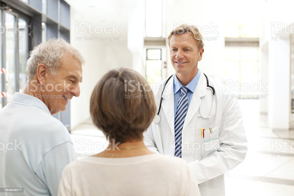 Injured Senior patient with wife and doctor stock photo