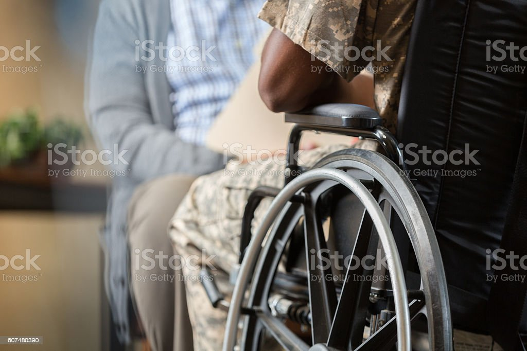 Injured veteran talks with psychiatrist stock photo