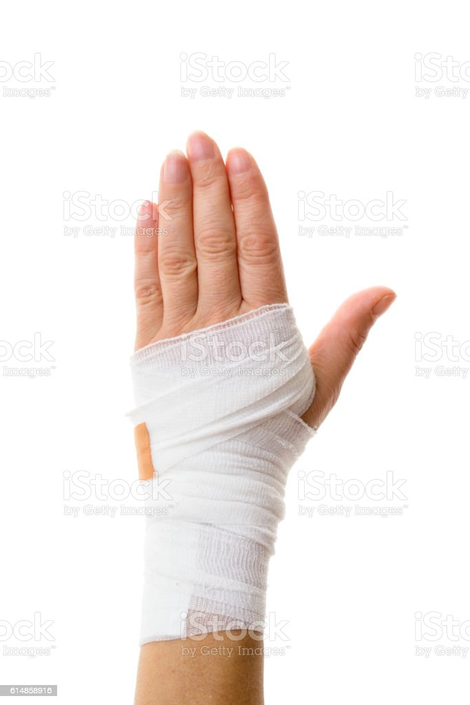 Injured woman hand with bandage isolated on white background stock photo