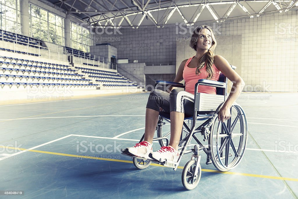 Injured woman in a wheelchair stock photo