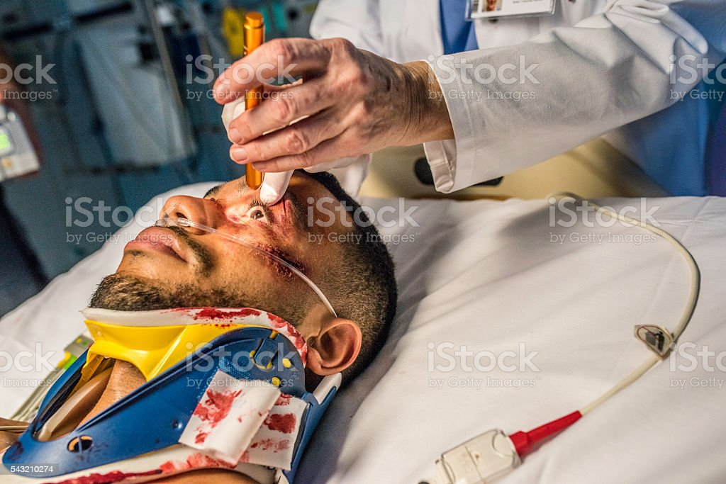 Injured young man in ER stock photo