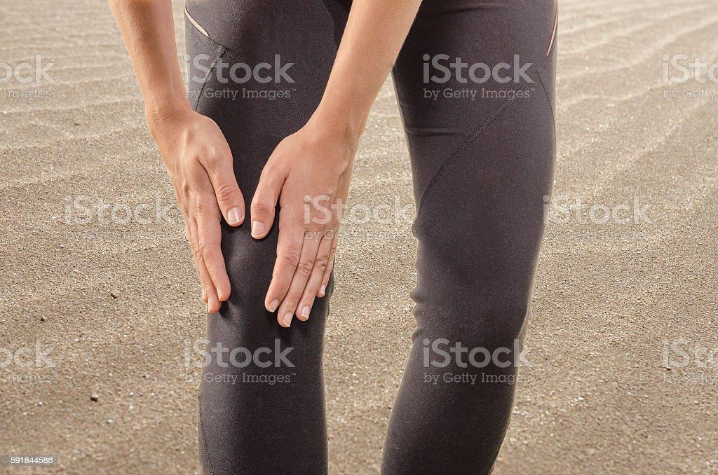 Injuries - sports running knee injury on woman. stock photo