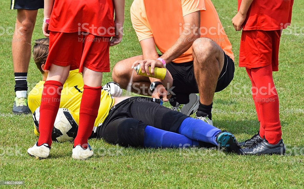 Injury at the kid's soccer match stock photo