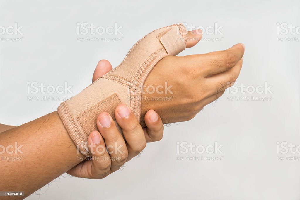 Injury hand with wrist supporter stock photo