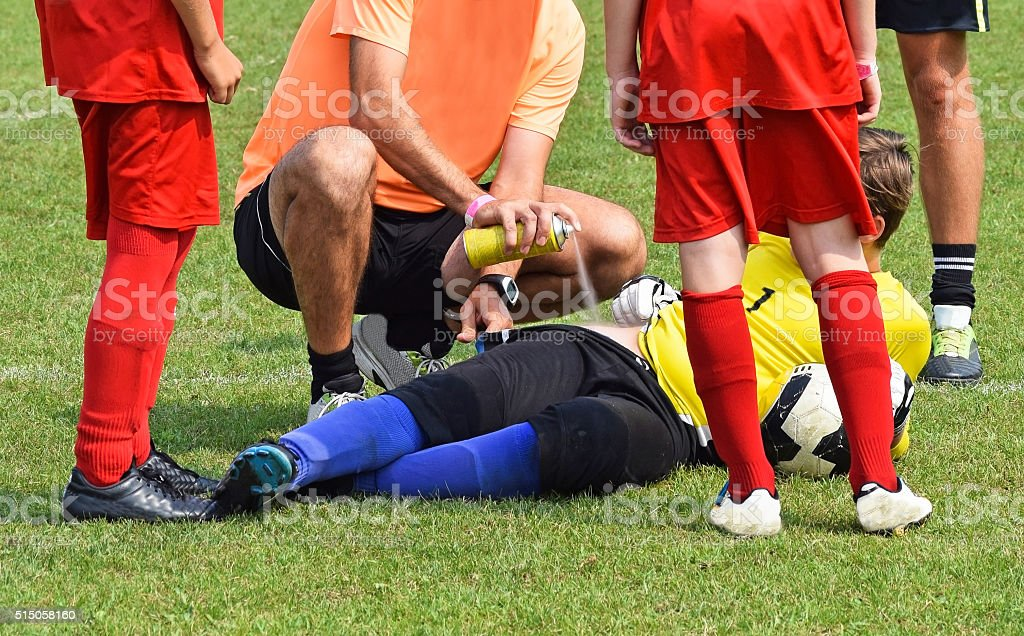 Injury on the soccer field stock photo