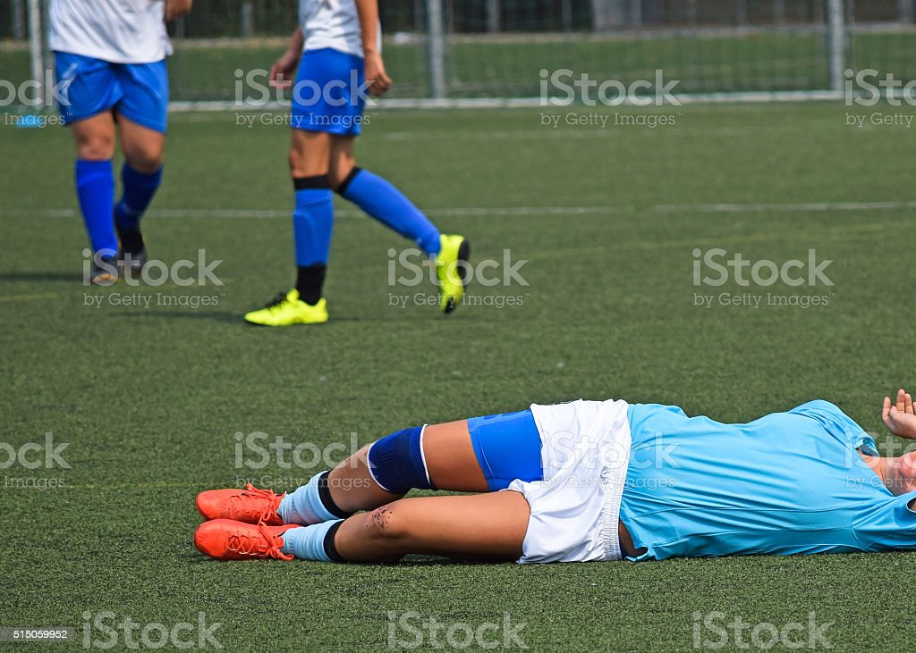 Injury on the women's soccer match stock photo