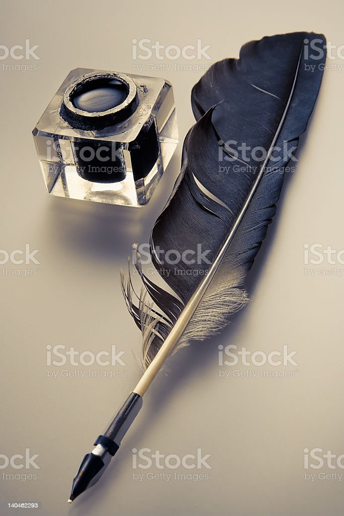 Ink and feather pen royalty-free stock photo