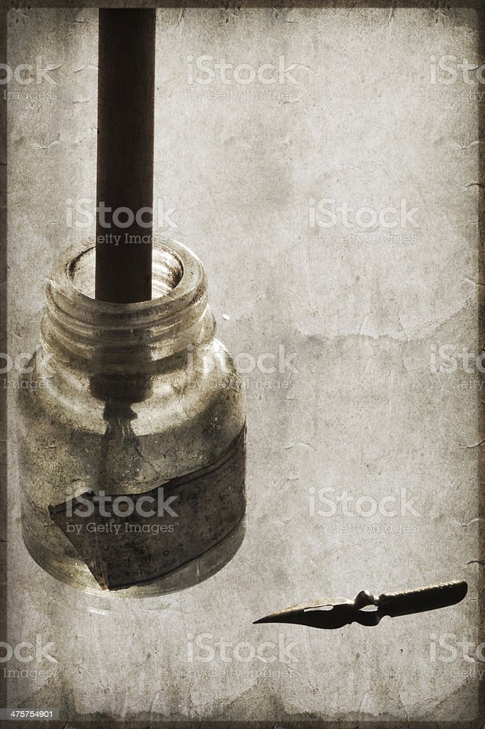 Ink bottle and nib pen, Vintage stock photo