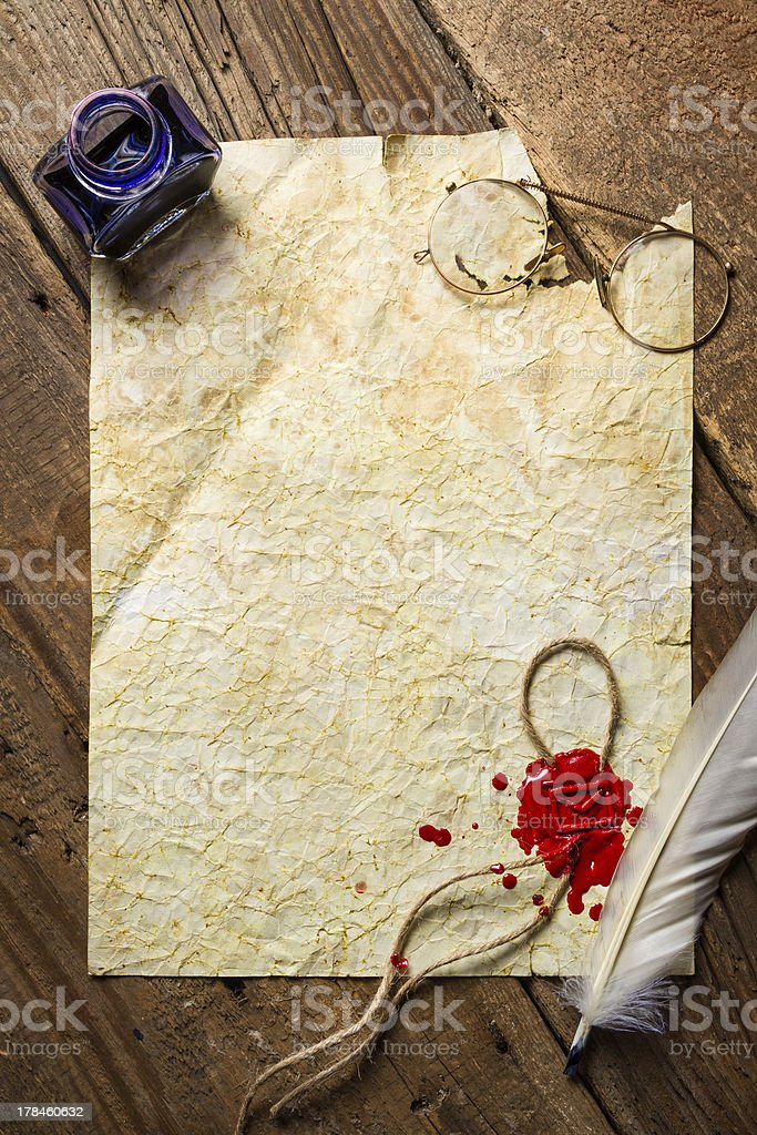 Ink, feather, glasses and red sealing wax stock photo