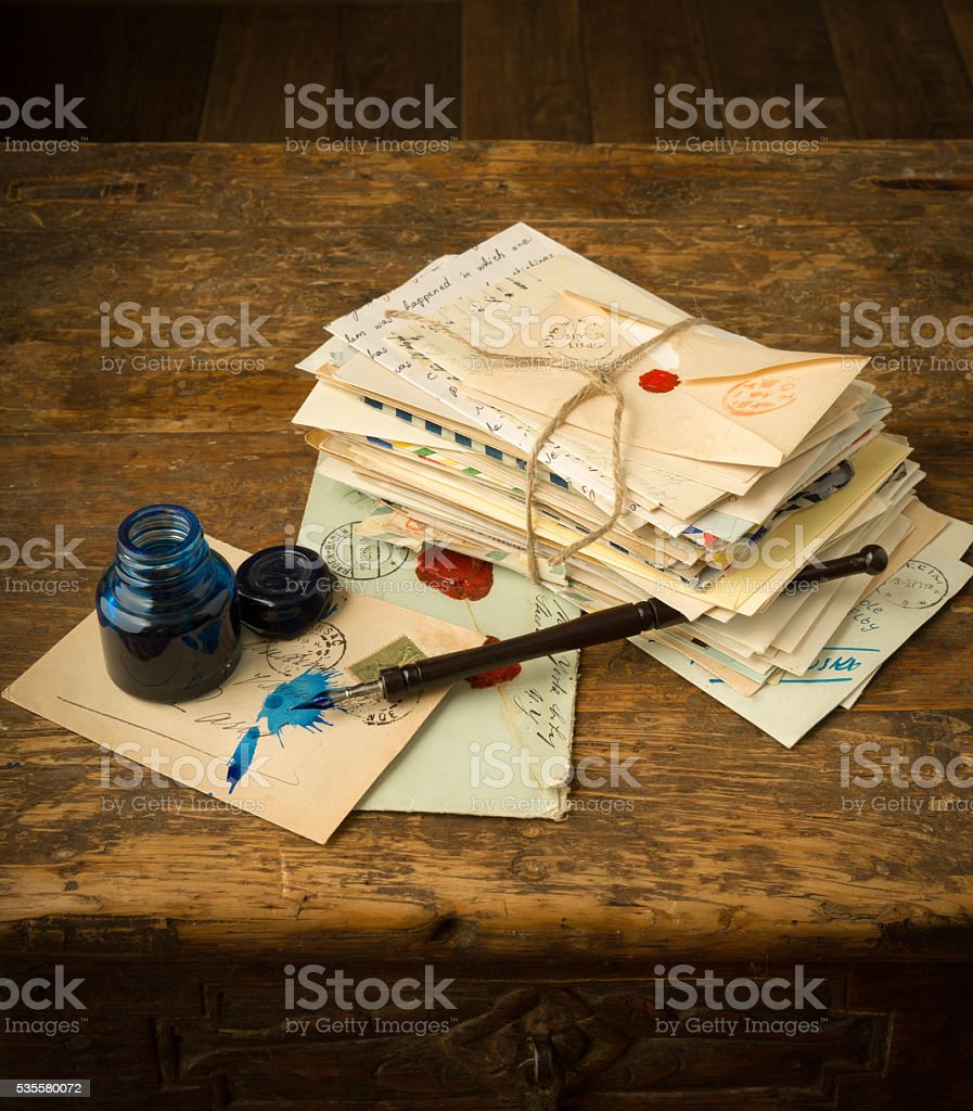 Ink pen and old letters stock photo
