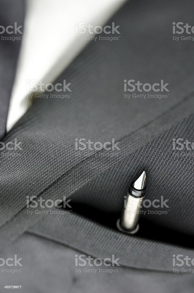 Ink pen in business suit pocket royalty-free stock photo