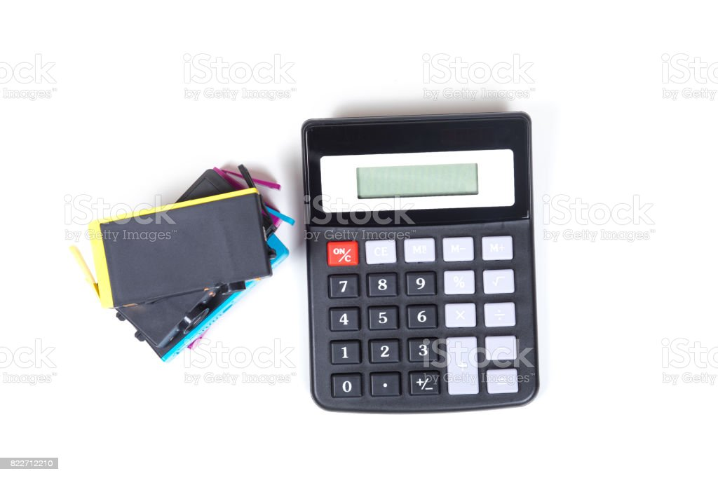 Ink printer cartridges and calculator viewed from above, isolated on...