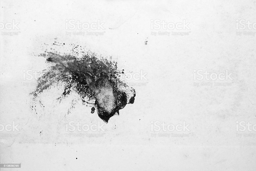 Ink smears on white paper stock photo