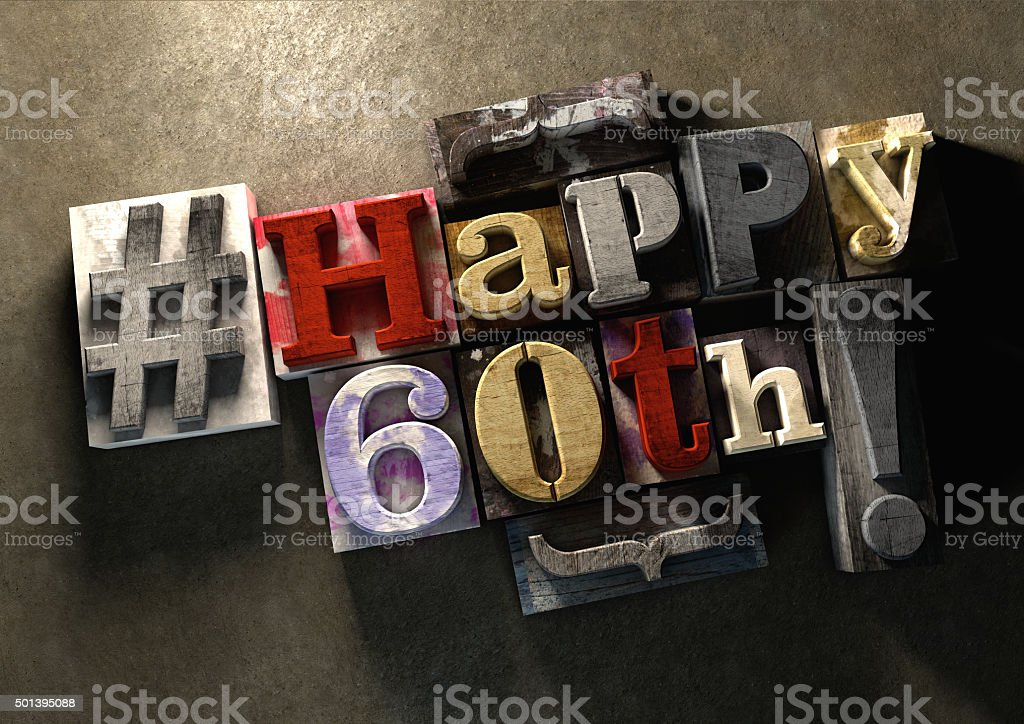 Ink splattered printing wood blocks with grungy Happy 60th birthday stock photo