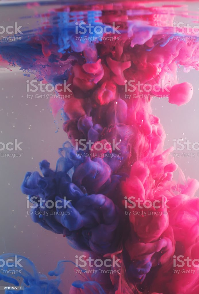 Ink swirling in water, cloud of ink in water stock photo
