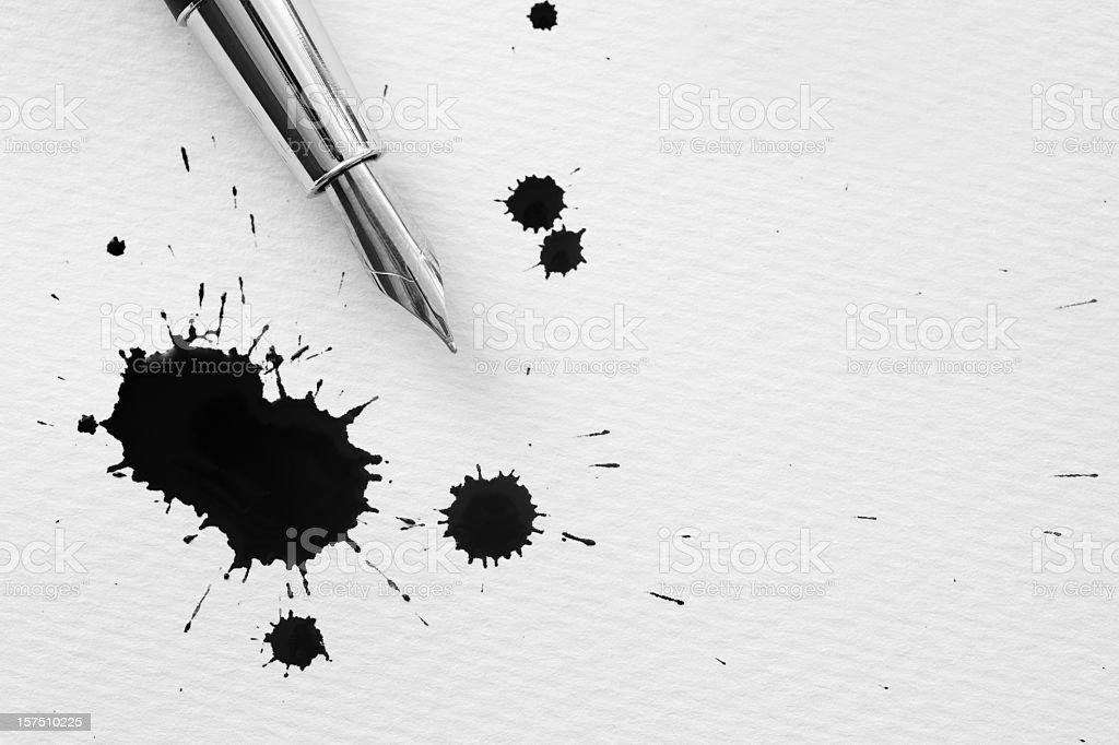 Inkblots and pen stock photo