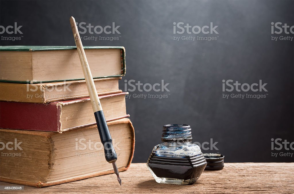 inkwell and dip pen stock photo