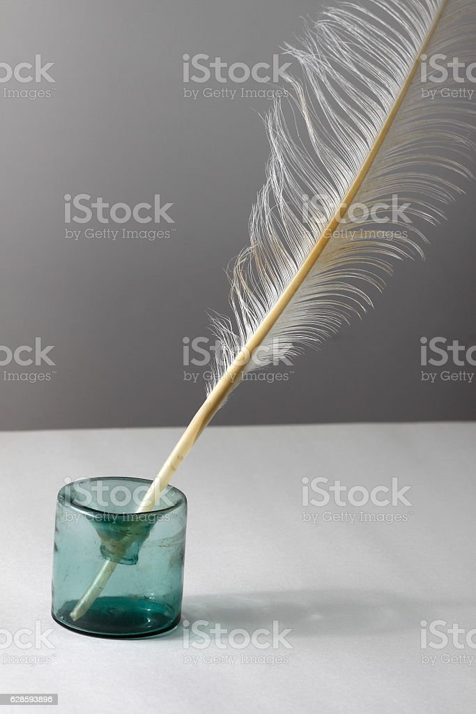Inkwell with feather stock photo