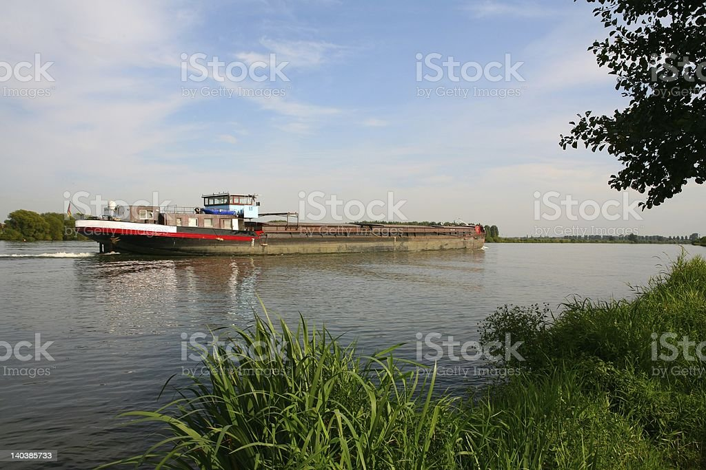 inland ship on river stock photo