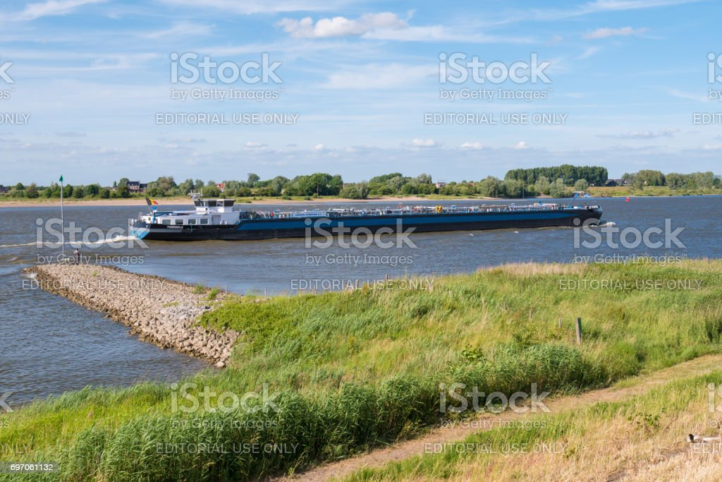 Inland tanker sailing upstream on river Waal, Netherlands stock photo