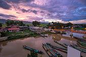 Inle lake tourist tour boat port sunset background