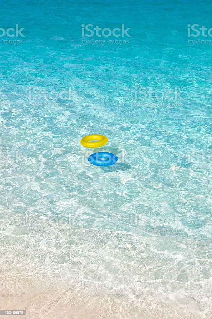 innertubes floating on the water royalty-free stock photo