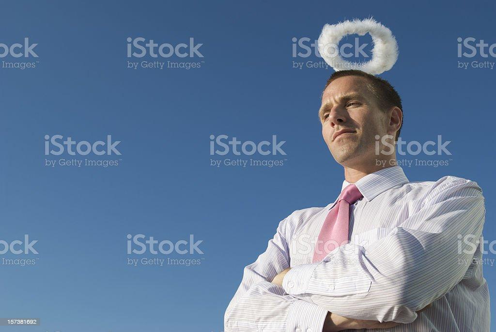 Innocent Angel Businessman with Fluffy Halo Blue Sky stock photo