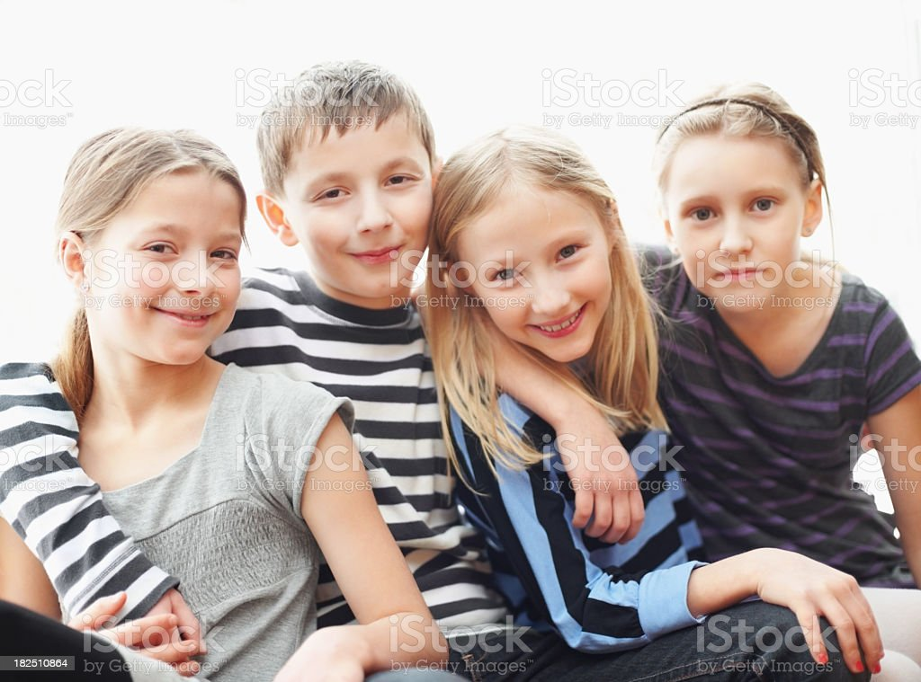 Innocent little children sitting together against white royalty-free stock photo