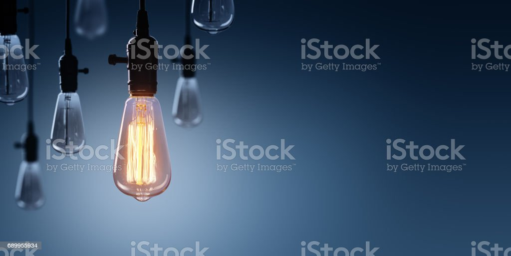 Innovation And Leadership Concept - Glowing Bulb lamp stock photo